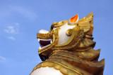 Detail one of the giant guardian lions at Ngahtatgyi Paya