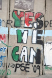 West Bank Separation Wall graffiti - Yes We Can in Palestinian flag colors