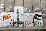 West Bank Separation Wall graffiti - Running flags and standing on shoulders