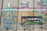 West Bank Separation Wall graffiti - Manners cost nothing! - Palestinian flag with فلسطين