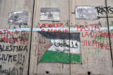 West Bank Separation Wall graffiti - Palestinian flag with فلسطين Palestine