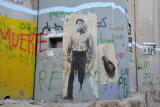 West Bank Separation Wall graffiti - quality painting of broken pottery and a man holding a piece of paper
