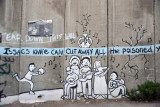 West Bank Separation Wall graffiti - Issac's knife can cut away all the poisoned yesterdays