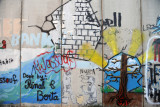 West Bank Separation Wall graffiti - Children and bricks signed by Rinal & Berta