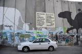West Bank Separation Wall graffiti - Bahamas Sea Food, menu for a restaurant next to the wall