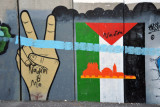 West Bank Separation Wall graffiti - Peace symbol with Palestinian flag