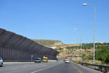 Hwy 60 with a large overhanging section of the West Bank Separation Wall  to deter Palestinian stone throwers from Bayt Jala