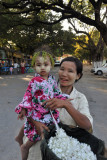 Flower peddler and girl with traditional painted face