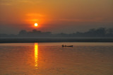 Sunrise with a small boat on the Irrawaddy River, Sagaing