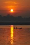Irrawaddy sunrise with a small boat