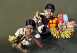The girls wade right up to the boat to sell their bananas