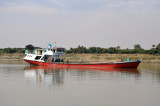 Substantial cargo vessel steaming up the Irrawaddy