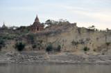 Red brick stupa on a sandy cliff by Nyaung U, the edge of the Bagan Archeological area