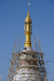 Workman on top of a stupa