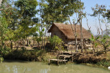 Thatched stilt hut along Mong Li Canal near Nyaungshwe