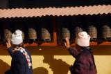 Turning prayer wheels, Tsamchem Gompa, Bodhnath