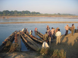 Tourists boarding canoes for a morning paddle, Chitwan National Park