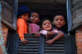Nepali kids in a window, Bandipur