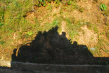 Shadow of the jeep with a full load of passengers on the roof, heading downhill from Bandipur
