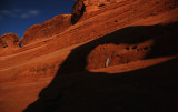 Moon Boy framed by Delicate Arch's moonlight shadow