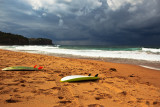 Surfboards and approaching storm