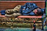 Man asleep on bench using topaz filter spicify