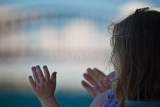 Child with Sydney Harbour Bridge backdrop