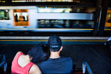 Couple on seat in railway station