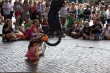 Busker jumping over girl