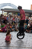 Busker on monocycle