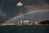 Manly ferry with rainbow on Sydney Harbour