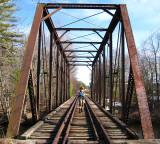 Julie on an abandoned rail road bridge