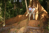 Julie and Tom on the roots of a Strangler Fig Tree