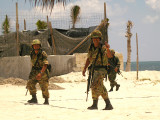Mexican soldiers patrolling the beach