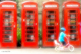 Cyclist and Phone Boxes
