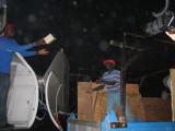 unloading supplies sent over by Samaritian's Purse (Billy Graham program)