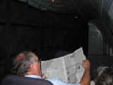 on the plane, 1st newspaper he had seen in a week, who cares if it is old