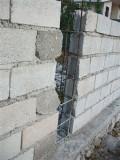metal braces between each wall section