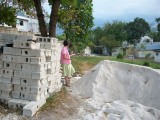 Martha checking out the blocks and sand (where is her hard hat?)