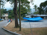 people living under the tarp on the basket ball court
