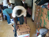 each worker that helped unload received a box of food as pay to take home with their families