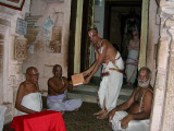 04-Periya nambi swami releasing Ammal acharyan swami receiving.jpg