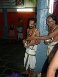 Sri mudaliyandan swamy offering sripAda theertham.jpg