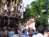 20-Parthasarathy Utsavam.Day 07.Ther.Sri Vaishnavas giving thrust from back of the ther.JPG