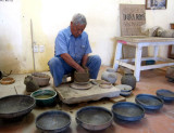 Valente Nieto, son of Dona Rosa, demonstrates pottery without a wheel