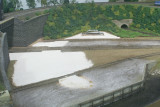 Additional dirt and concrete apron