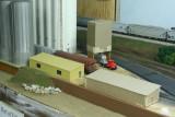 Cardboard office mock-up next to finished styrene building