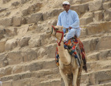 Experienced camel riders balance via a leg around the pommel.