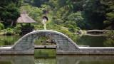 Woman and parasol atop Kokō-kyō