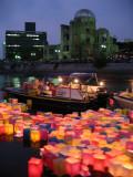Peace Lanterns moving upstream after nightfall